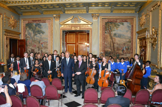 Lord Marland of Odstock, President and Maestro Paul Carroll, Artistic Director and Composer-in-Residence, with The Commonwealth Youth Orchestra and The Commonwealth Children's Orchestra & Choir